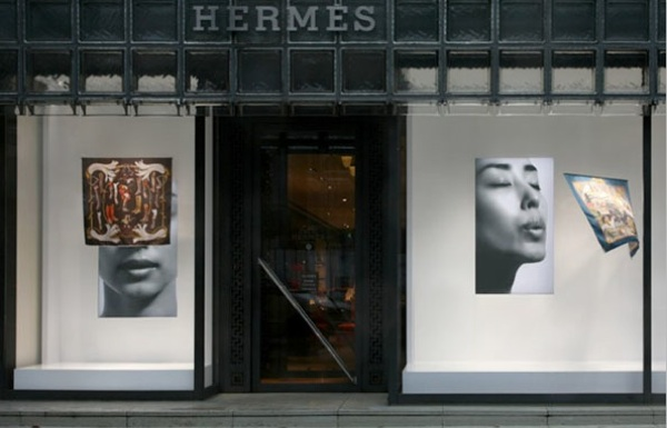 The art of window displays. Tokyo. The store front uses timed videos of a woman blowing and hidden fans to highlight Hermes iconic scarves.jpeg