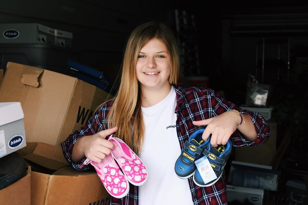 """Haylee Moore  Founder   From just a thought in the mind of a teenager to growing into the non-profit organization it is today, Project 2:4 has widely expanded into making a difference in the lives of others by just giving out pairs of shoes. At just 18 years old, Haylee, founder of Project 2:4, has made an impact on hundreds of kids lives by providing them with the new shoes that they've never had, with the help of some close friends and family.  Haylee combined her passion for shoes with her passion for serving and has built this project from the ground up and says she """"Can't wait to see what the future holds for Project 2:4""""."""