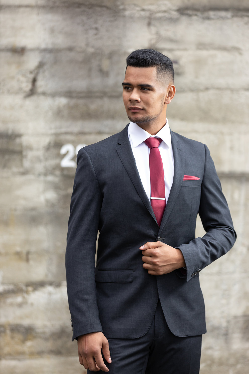 Charcoal - Slim Fit- Notch lapel- 2 button suit jacket- Tapered suit trouserHire price $120 NZDReg: 88—132Short: 88—128Tall: 92—116