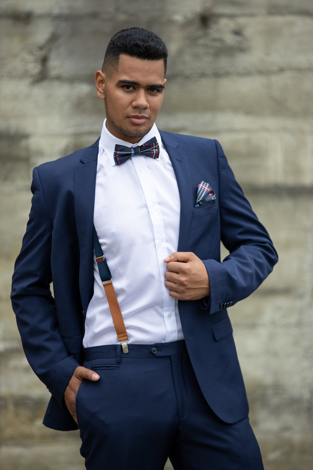 Custom - There's nothing like a suit that's been made especially for you. Have your choice of style, fabric, colour, and buttons, all made-to-measure.—We can custom make braces (photo on left), ties, bows and pocket squares to accessorise your look.—Groom will receive a complementary shirt to match.