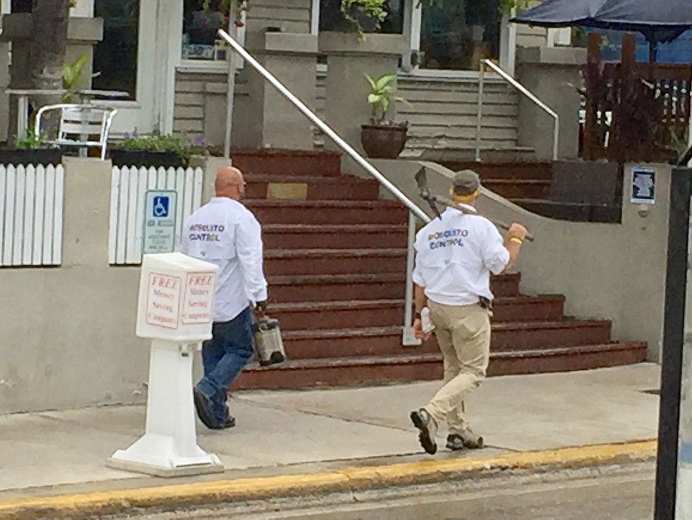 """Did I mention Key West is a bit funny?? If you can't read their shirts, they say """"mosquito patrol!"""""""