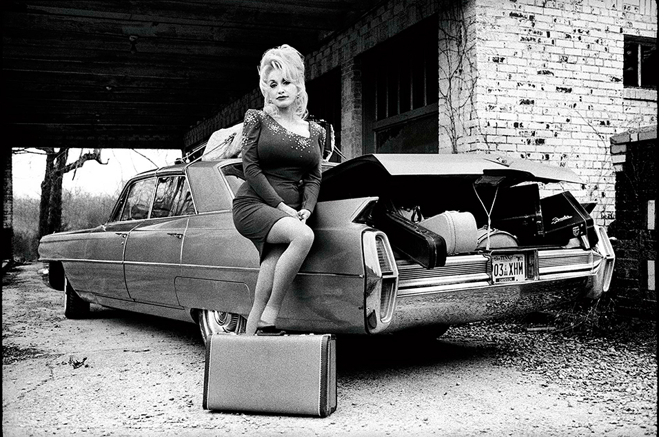 Dolly Parton and a 1963 Cadillac Sedan de Ville