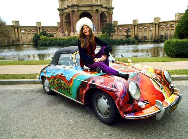 Janis Joplin poses with her psychedelic Porsche 356