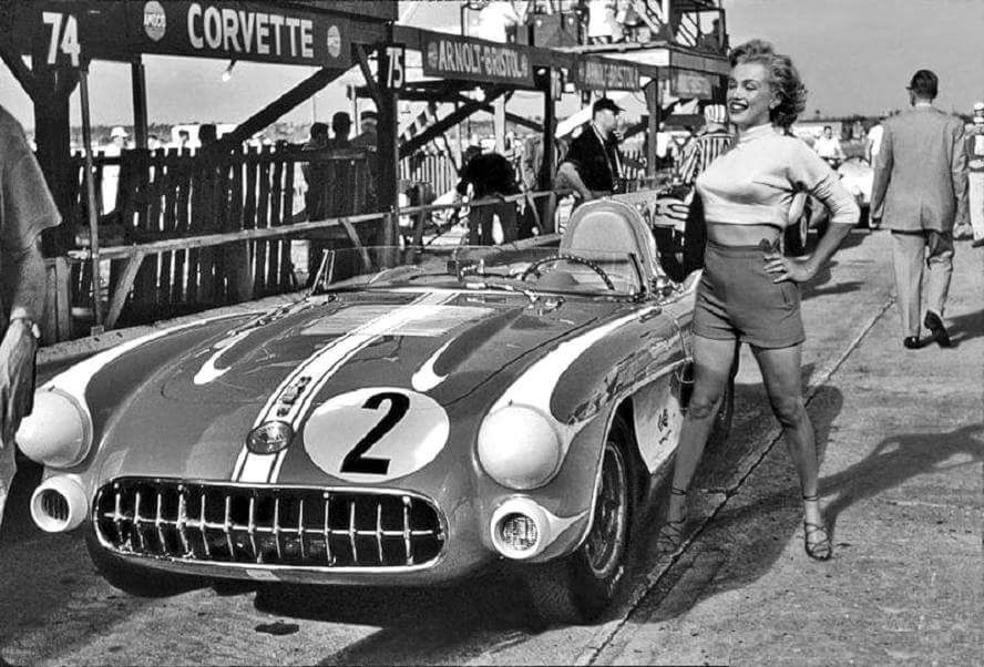 Marilyn Monroe poses for photos next to a '56 Corvette racer