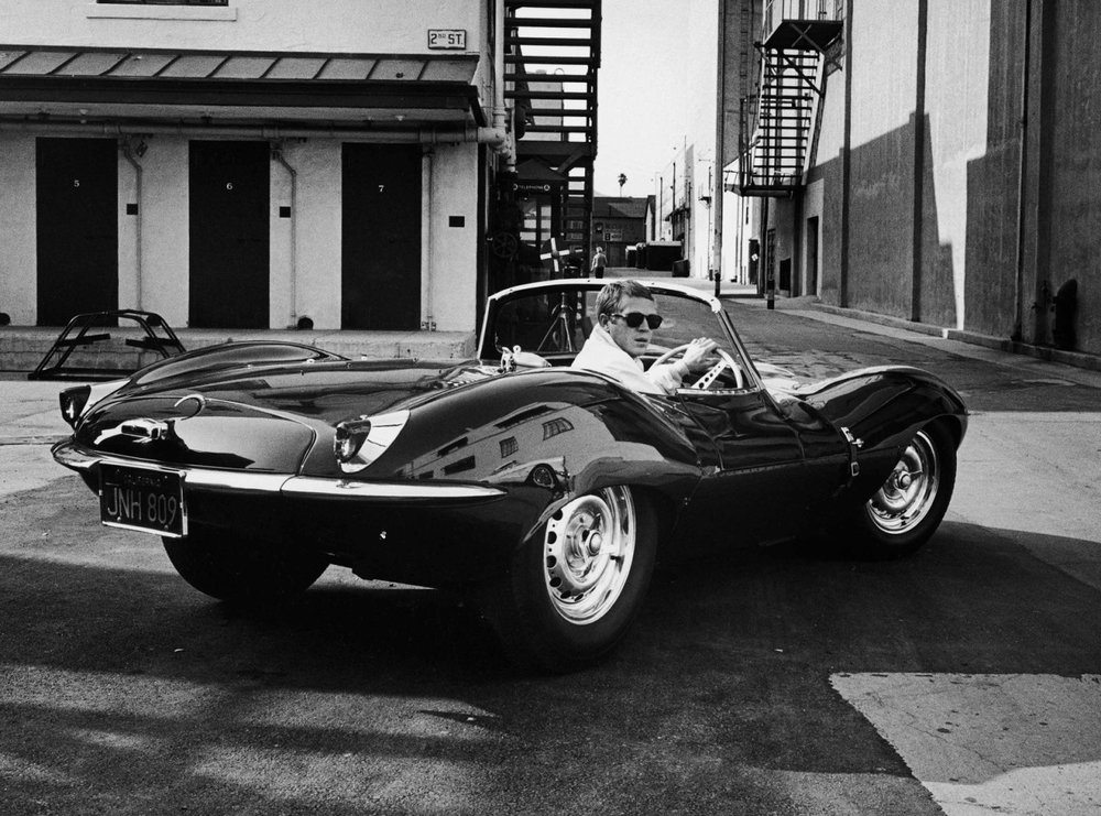 Steve McQueen on the studio lot - '57 Jaguar XK-SS
