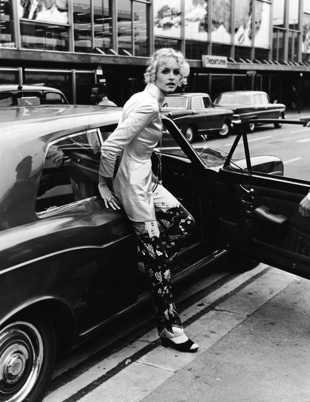 Sixties supermodel Twiggy steps out of her Rolls Royce Corniche