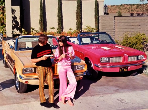Sonny & Cher with their matching George Barris custom Mustangs