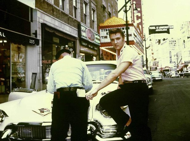 Elvis and his '57 Cadillac getting a ticket