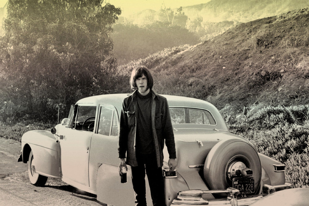 A youthful Neil Young and his '41 Lincoln