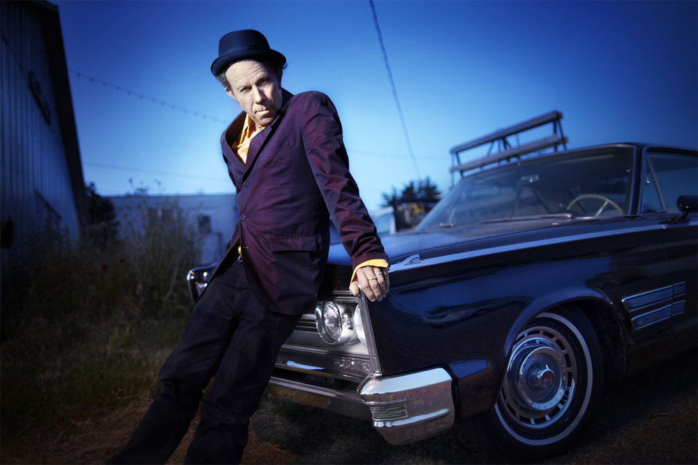 Tom Waits leaning on a '65 Chrysler 300