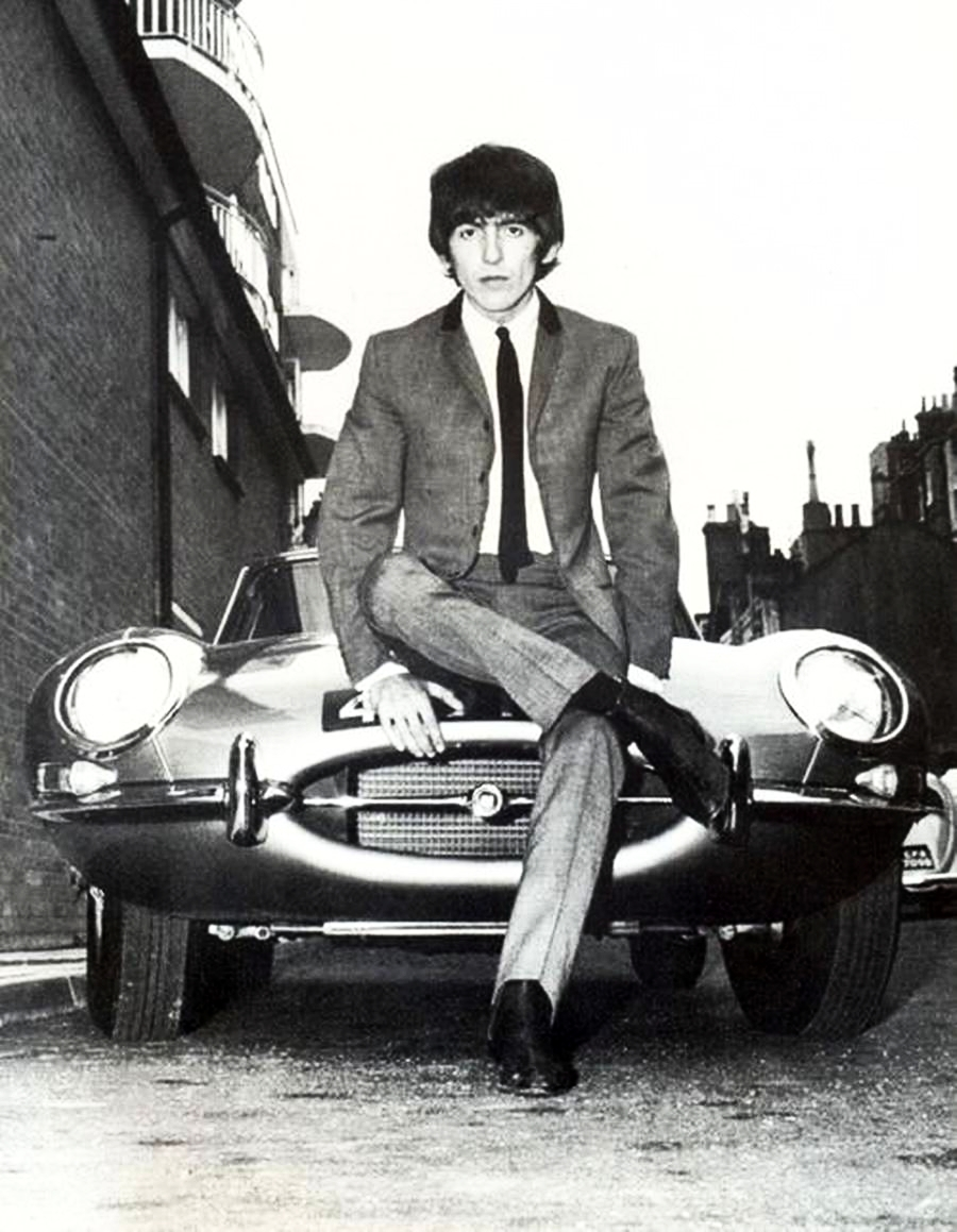 George Harrison shows off his series 1 E-Type