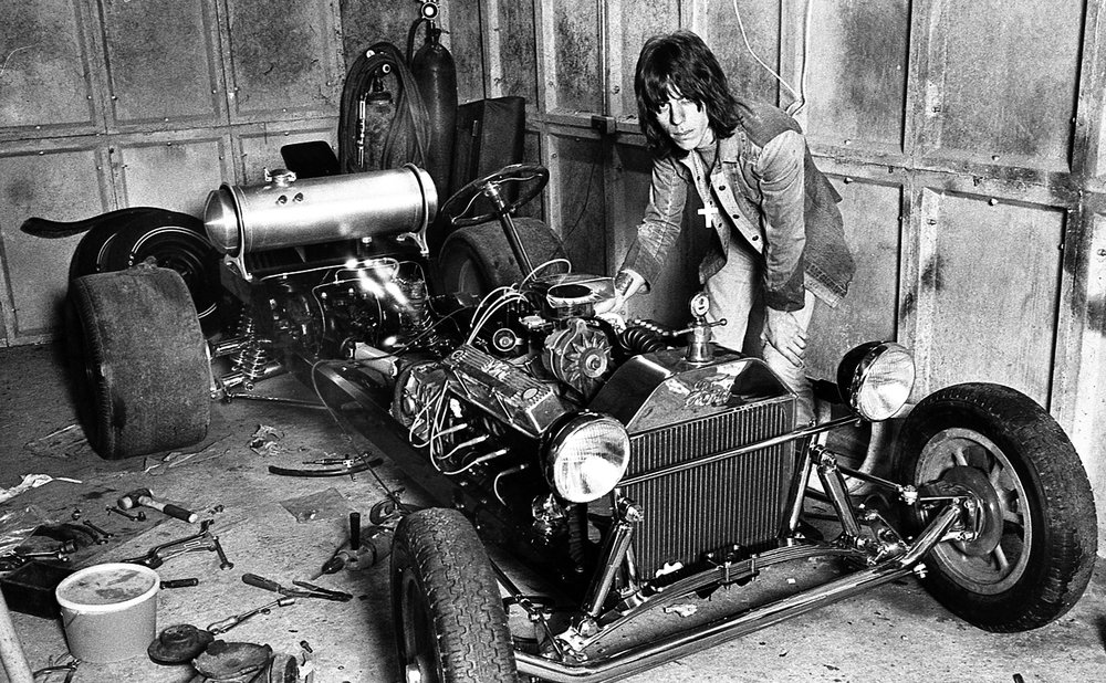 Guitar hero Jeff Beck working on one of his hot rods