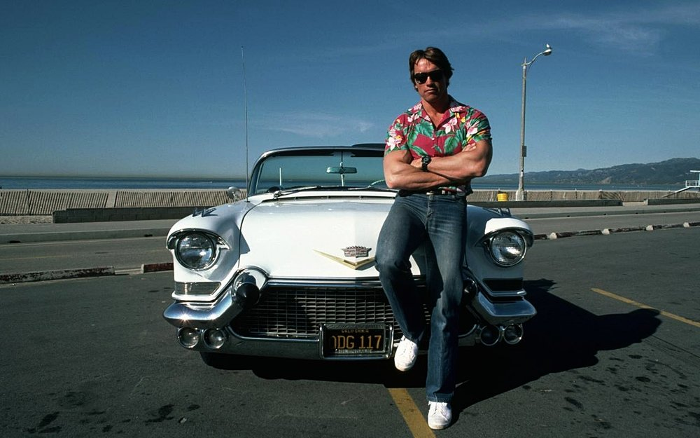 A young Arnold Schwarzenegger and his '57 Cadillac
