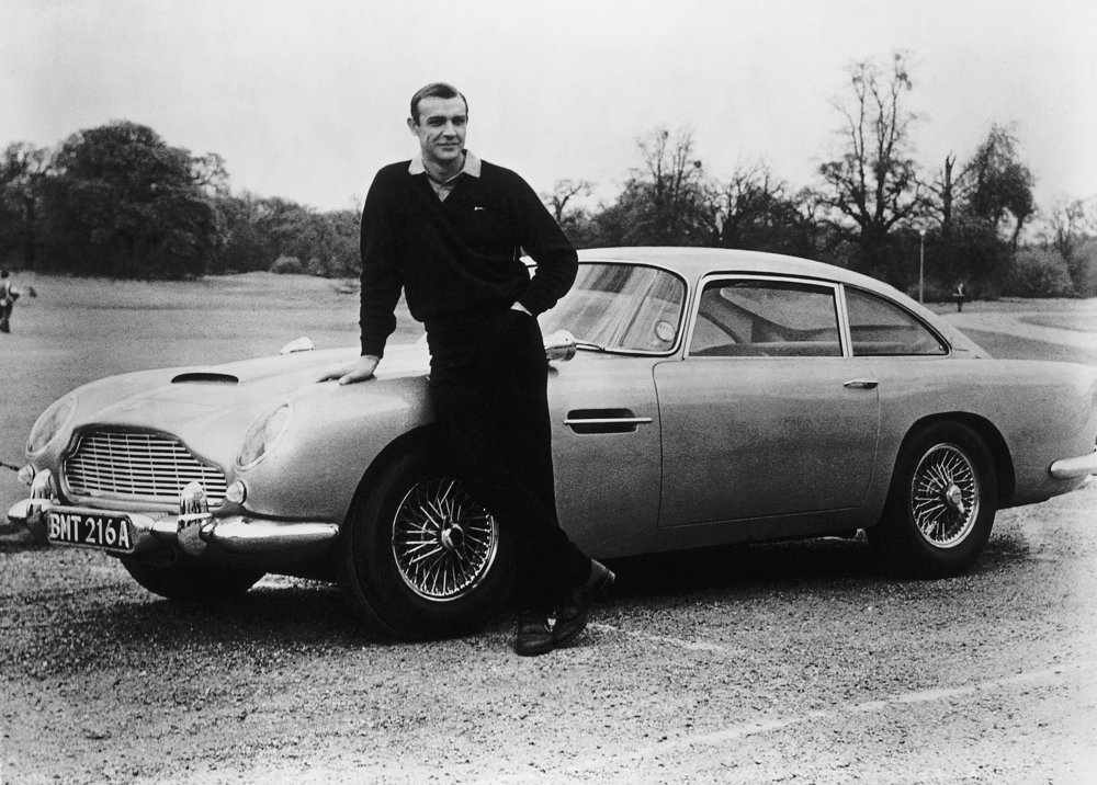 Sean Connery poses with the 007 Aston Martin DB5