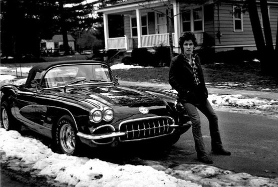 Bruce Springsteen and his 1960 Corvette parked outside his chilhood home in Freehold, NJ