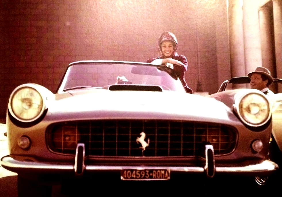 Audrey Hepburn with early '60s Ferrari 250 spyder