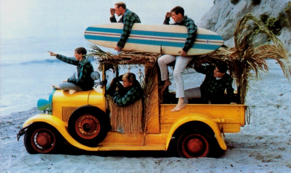 Beachboys with yellow jalopy - early '60s publicity shot