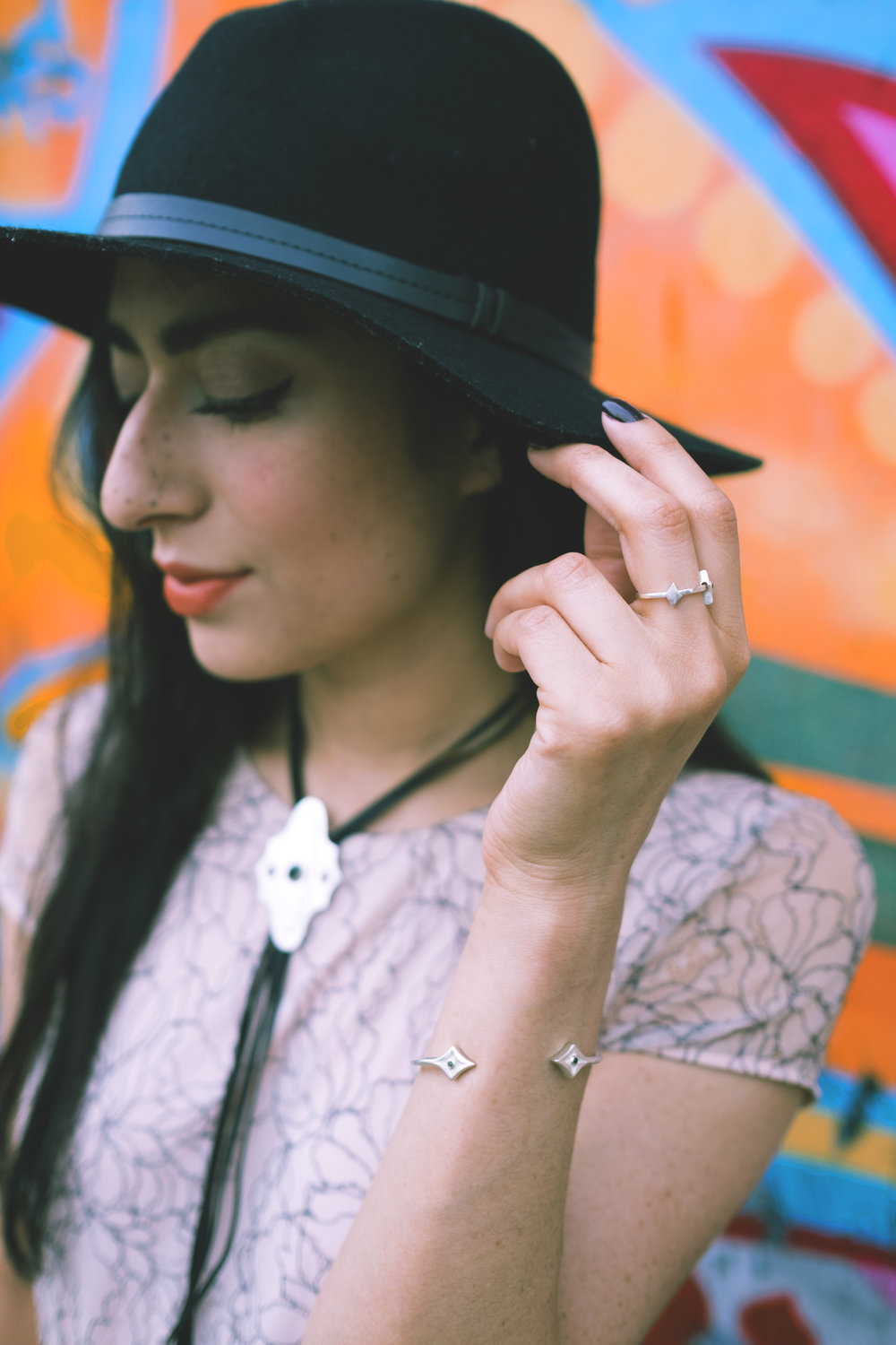 Wearing the Woven Trails Bolo Tie, Desert Night Ring, and Noche Negra Bracelet.