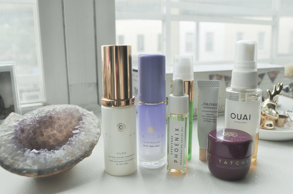 Some of my favorite minis (from right):  Tatcha Camellia Cleansing Oil , T atcha Luminous Dewy Skin Mist ,  Tata Harper Resurfacing Serum ,  Herbivore Botanicals Phoenix Facial Oil ,  Shiseido WrinkleResist24 Eye Cream ,  Tatcha Violet-C Radiance Mask ,  Ouai Wave Spray