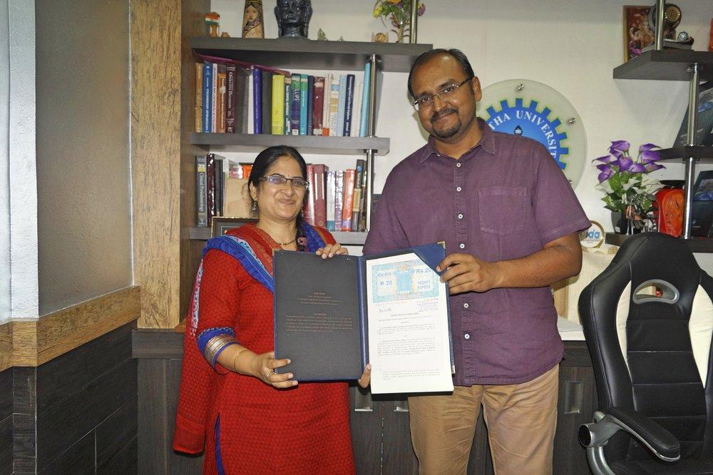 Dr.Savithri Shivakumar & Dr. Deepak Nallasamy with the MOU signed
