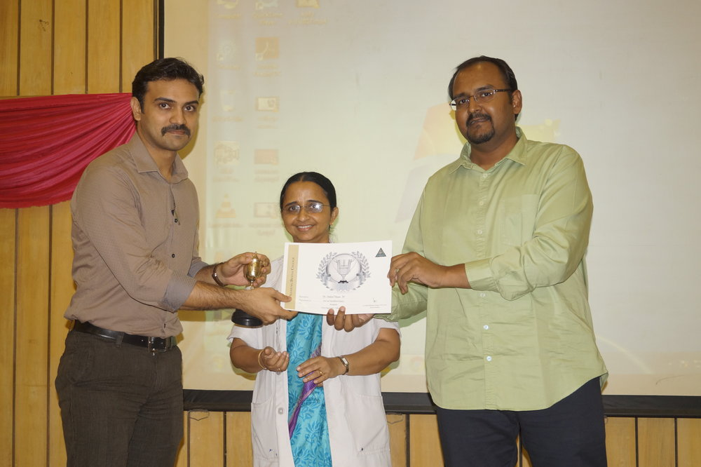 Dr. Nabeel receiving the Punctuality Award.