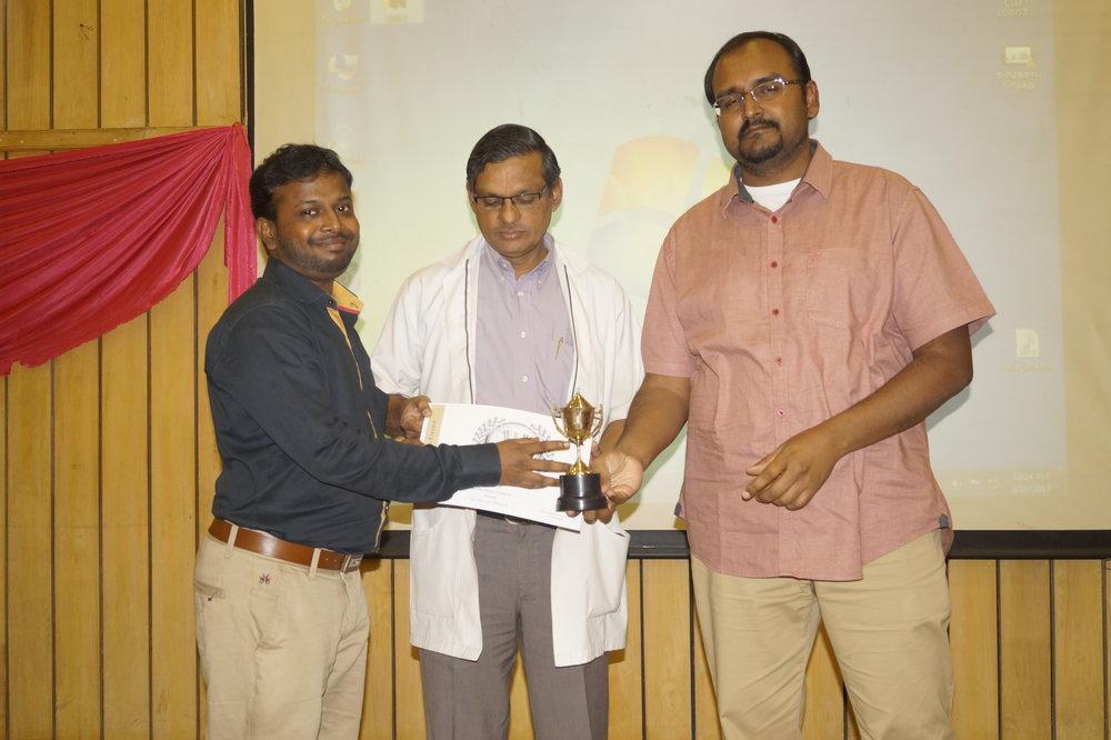Dr. Pradeep receiving Workaholic Award