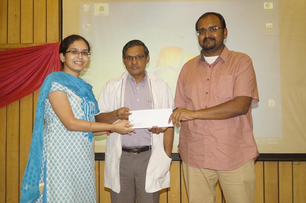 Dr.Vishnupriya receiving her promotion order as Professor