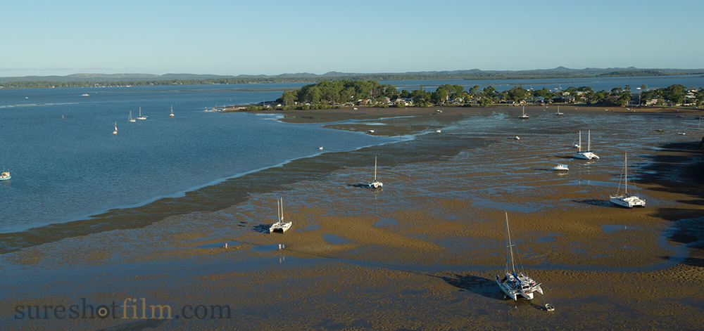 Drone aerial photography of yachts on Moreton Bay at low tide