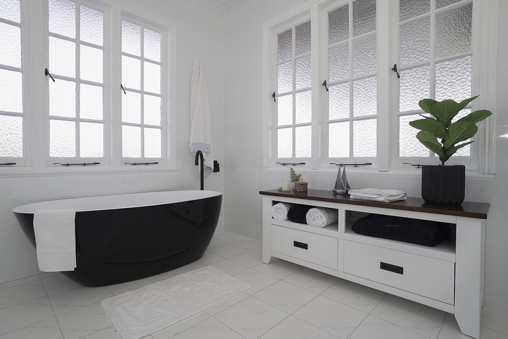 Crisp, clean, black and white bathroom — internal real estate photography