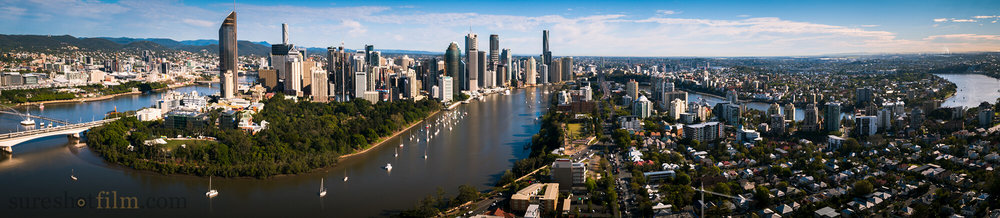 Drone aerial photography of the Brisbane River snaking through the city.