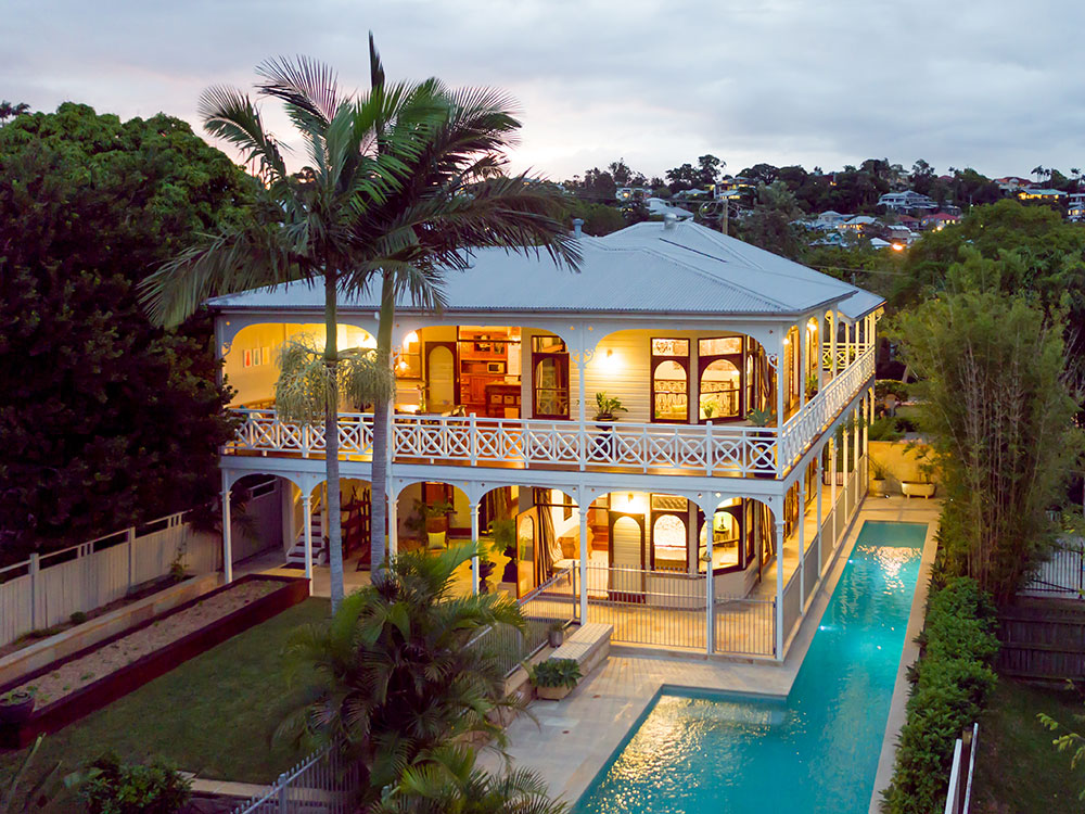 Twilight drone photography of Queenslander home