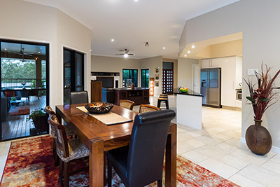 Real estate photography of living area and dining area in Brisbane home