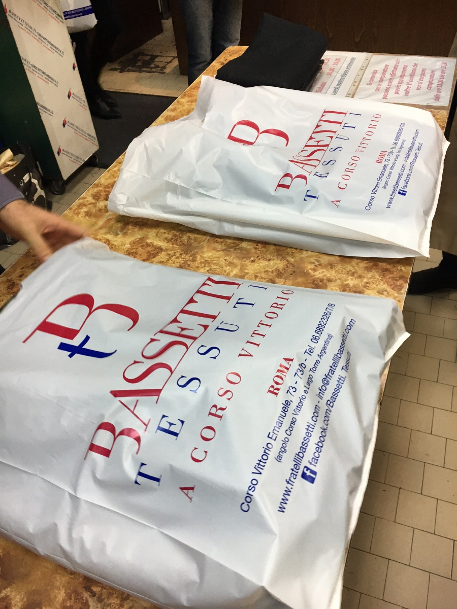 Fabric cut and bagged in Bassetti Tessuti bags.