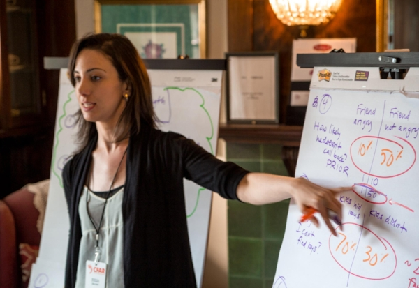 Julia Galef, co-founder of CFAR, giving a workshop. Picture from their website.