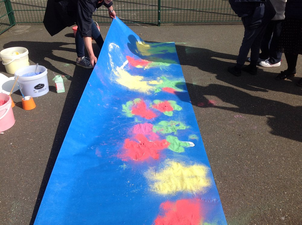 Nine huge paintings created on the basketball court with students at Heltwate Scool