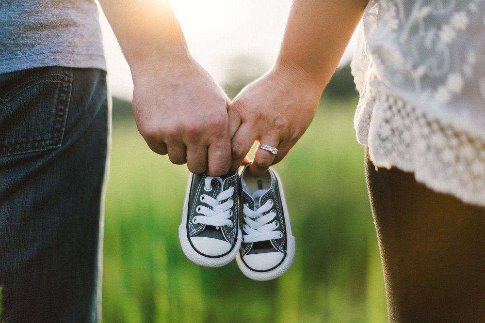 couple with baby shoes.jpg