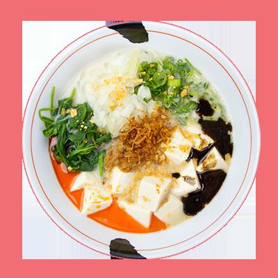 Spicy Creamy Vegan Ramen  vegetable broth: tofu, onion, green onion, spinach, crispy onion, garlic chips, garlic oil, chili oil, sesame seeds » served with thick noodles  (Photo: jinya-ramenbar.com/)