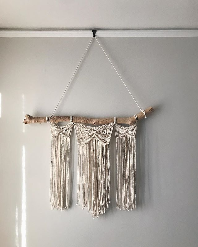 "One of my goals when I moved house in the Summer was to start to slowly fill our space with handmade things. Things full of texture, that told a story, that would make my house over the years feel so much like home.  I made this wall hanging from a piece of driftwood I found on Spittal beach in Berwick, and used a pattern from the amazing @createaholic and her Macrame book. I taught myself a few knots, watching YouTube videos as I went. It's a simple piece, but as with everything, it's easy when you know how.  It hangs in Rory's room above her bed, and I love how excited she gets whenever she sees it and says ""mama, look at that nice wall hanging you made for me"". She thinks it's magic, that I made it. I kinda think it's magic too.  It took me 4 months from start to finish, not because it's hard but because I started it one evening and didn't pick it up again until 4 months later. I'm so glad I went back to it, because it's ok sometimes for things to take some time ✨ #ourhitchinhome"