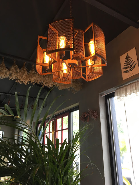 Figured I'd show you a pic of their modern-industrial light fixtures, though I doubt many of you care. lol