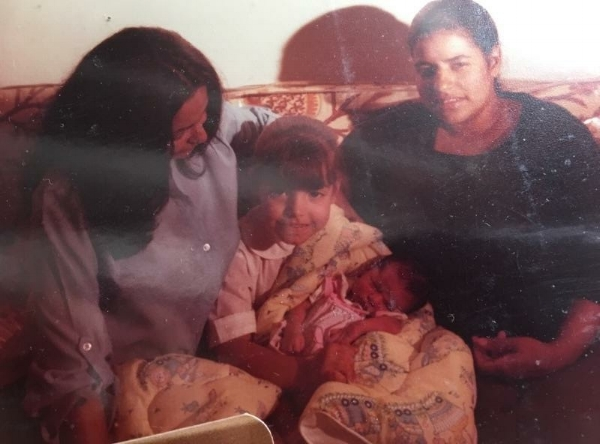 Left to Right: Great Grandmother, my mother holding my first Titi, & my Grandmother.