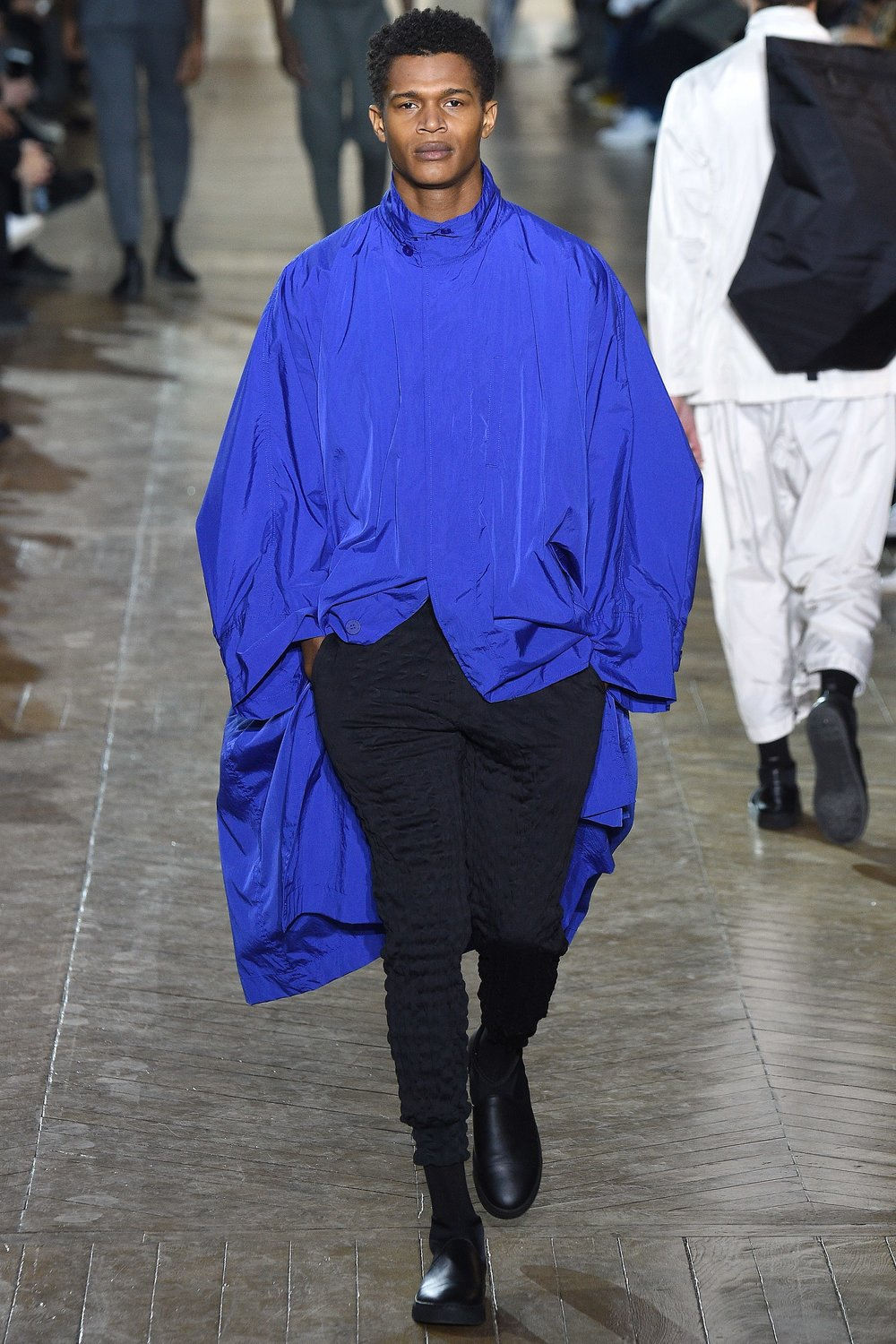 The most beautifully bold blue parka.  Issey Miyake, Courtesy of Vogue.