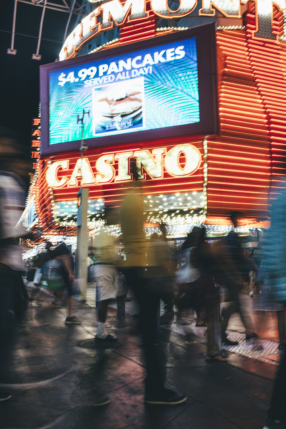 A photo by Luther Redd of the bustling Fremont Street at night.