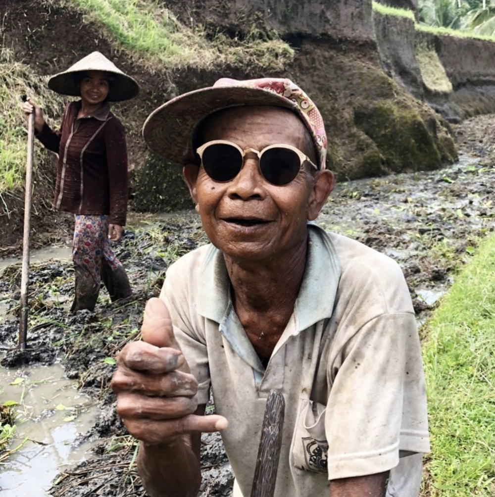 Not only is rice farming a major staple to the Balinese economy, but it's also the center of many traditional Balinese rituals, as the farming process is seen as a cycle of hard work, spiritual connection, and celebration. Pictured here is a local farmer we spoke with sporting the    É  tienne Marcel  frames.