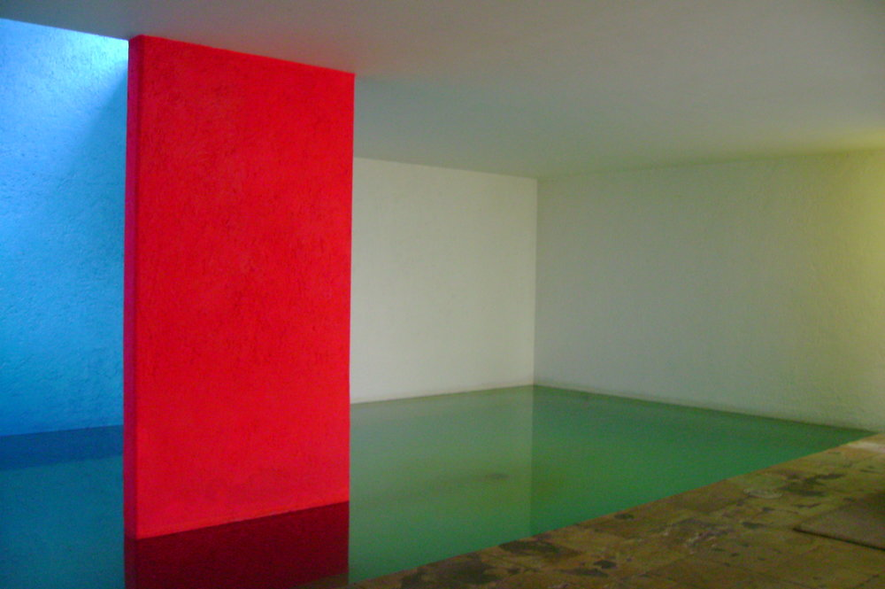 Bright colorblocks accent the indoor wading pool at Casa Gilardi.