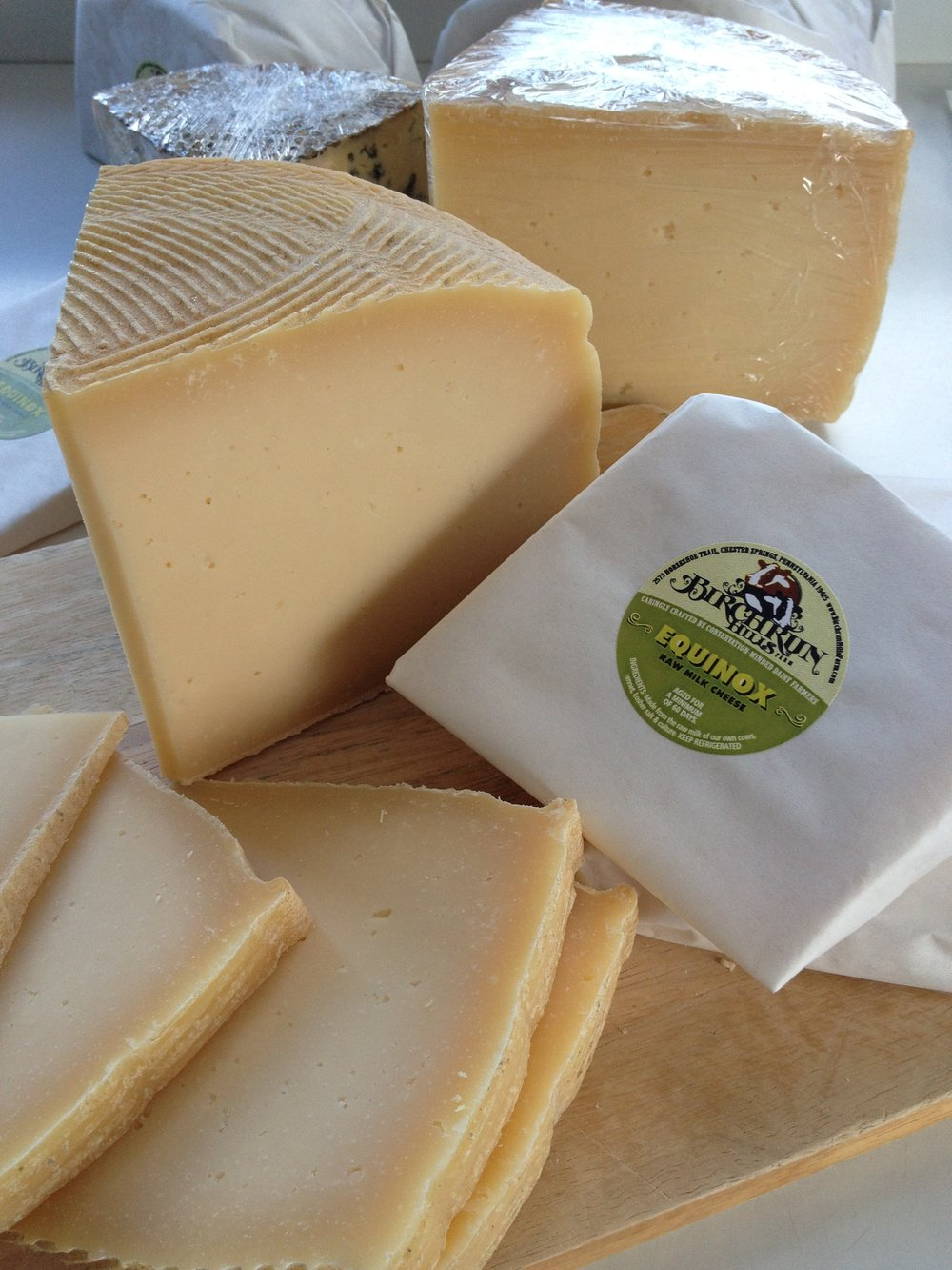Equinox ~ raw cow's milk ~ Take a trip to the Alps with this Swiss-inspired mountain cheese. Firm, mild, and nutty with a hint of salt and a toasty brown butter finish. Serve with seasonal fruit and a glass of Riesling, or melt over roasted fingerling potatoes.