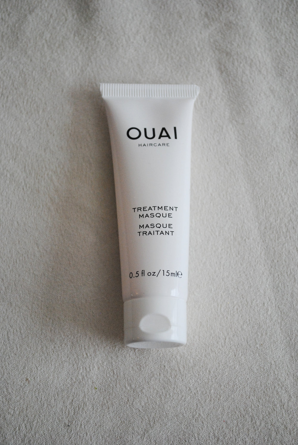The QUAI Treatment Masque  What it claims to do: This restorative mask helps care for damaged hair and leaves strands feeling smooth and touchably soft.  This hair mask does leave your hair smooth and soft for sure. Super easy to use too and perfect for after workout showers. Just apply the mask before you shower leave in 5-10 minutes and rinse. You will notice your hair is left silky smooth.