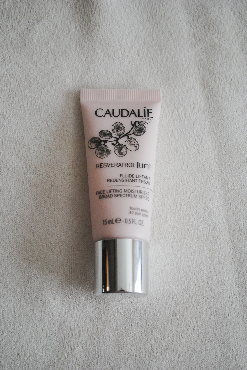 CAUDALIE- Resveratrol Lift Face Lifting Moisturizer Broad Spectrum SPF 20  What it claims to do: This is anti-aging daytime moisturizer that combines resveratrol and hyaluronic acid to visibly lift, firm, and plump skin.   I have been using this moisturizer as a face primer and love it! It has everything that I want in a daytime moisturizer. I love that it has SPF in it as well as works as a face lifting cream all well giving me the perfect base for makeup. I have combination skin so I also appreciate that it doesn't leave my skin feeling oily or greasy.
