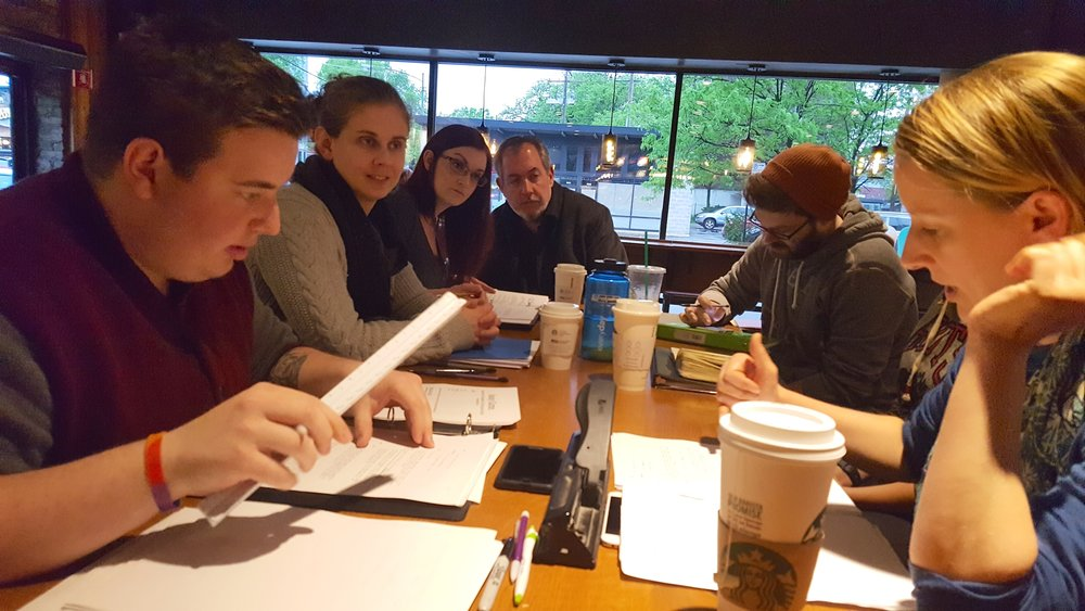 "Holly Robison, second from left, at a production meeting for Ghostlight's 2016 festival of new works, ""Six Authors in Search of a Character."""
