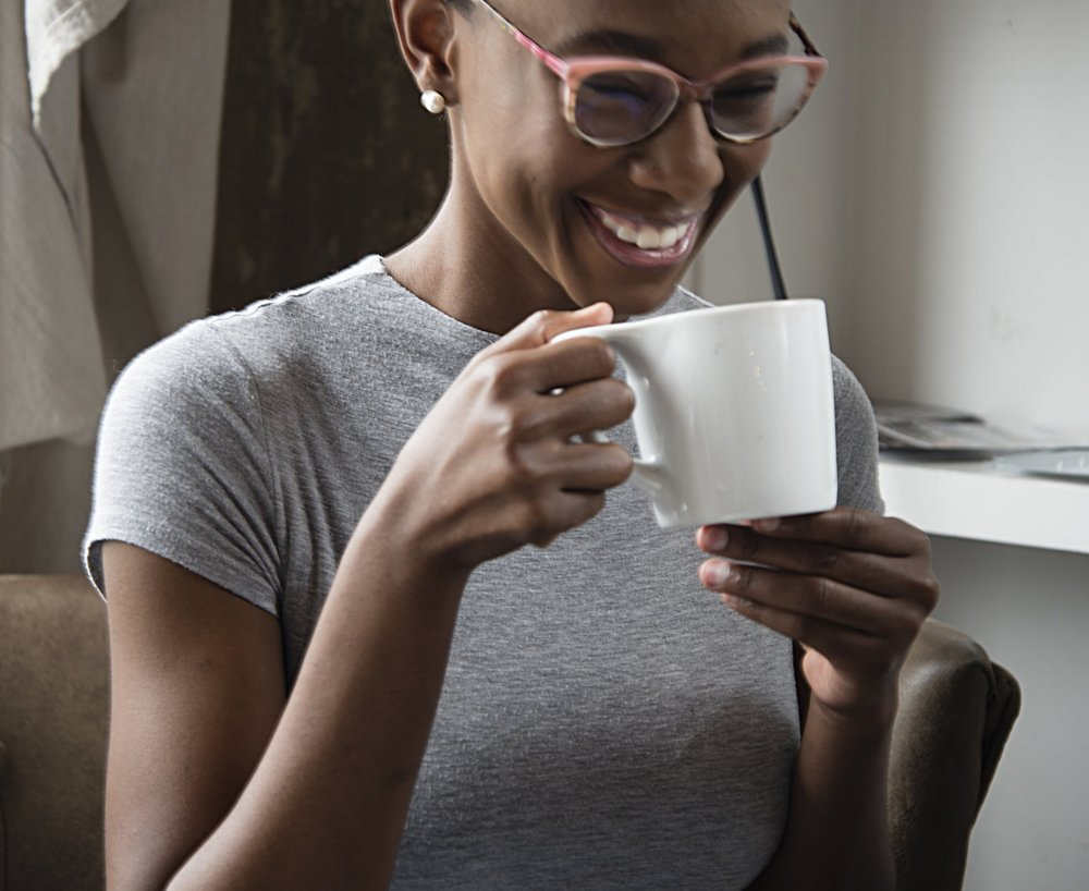 black-woman-coffee-cup-smiling