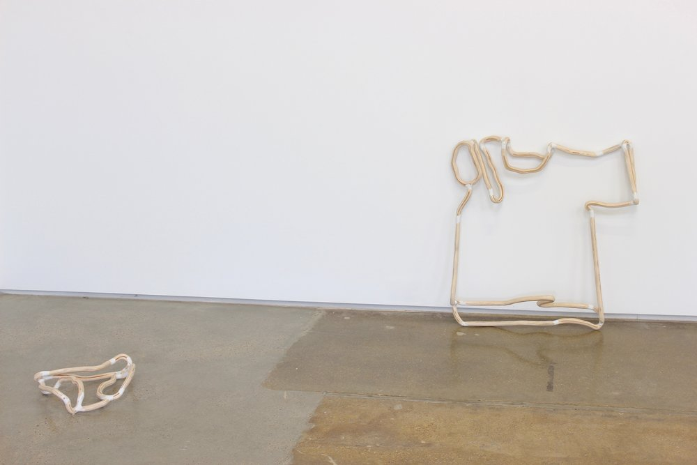 "Underwear on the Ground and T-shirt on the Ground,  2016. 6"" H, 16"" W, 14 D and 7"" , 29""H, 30"" W 7"" D. Plywood, epoxy putty, wood filler, polyurethane. Lee Relvas."